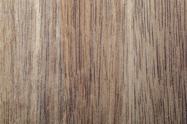 Zbliżenie tekstury drewna akacjowego rustykalny wygląd z węzłami żył i kopią przestrzeni