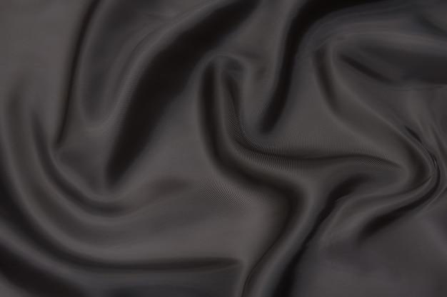 Zbliżenie tekstury naturalnej beżowej tkaniny lub tkaniny w kolorze brązowym. tekstura tkaniny z naturalnego materiału tekstylnego bawełnianego lub lnianego. beżowe płótno tło.