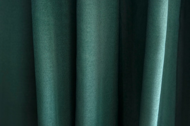 Zbliżenie zielonej tkaniny z zakładkami