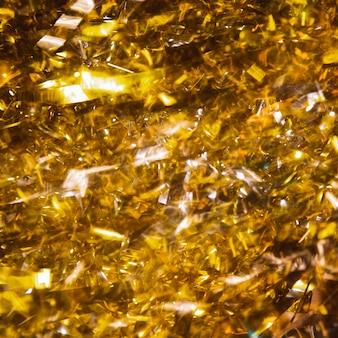 Zbliżenie złote konfetti na rocznicę nowego roku