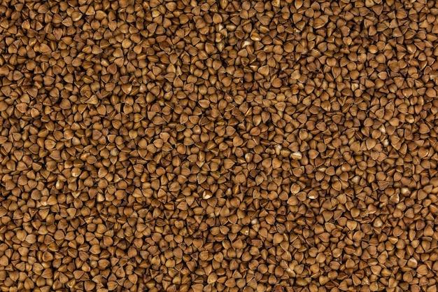Zdjęcie kasza gryczana spożywcza. tekstura tła kasza gryczana ziarna.