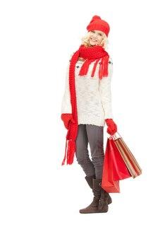 Zdjęcie młodej dziewczyny z torbami na zakupy...