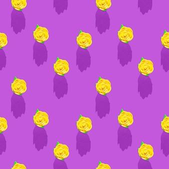 Zdjęcie w postaci bezszwowego wzoru żółty kwiat z zielonymi liśćmi z cieniami na kolorowym