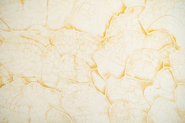 Zdjęcie żółtego marmurowego kamienia tekstury abstrakcyjnego tła