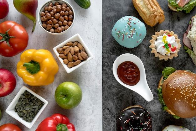 Zdrowe i niezdrowe jedzenie na podwójnym tle