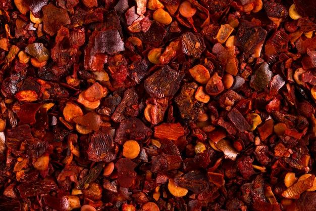 Zdruzgotana wysuszona chili pieprzu czerwień, zakończenie makro-. , copyspace.