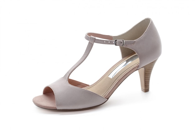 Żeńscy szpilki sandały odizolowywający na bielu