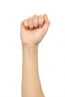 Żeńska ręka pokazuje mylnego pięść gest odizolowywającego na bielu
