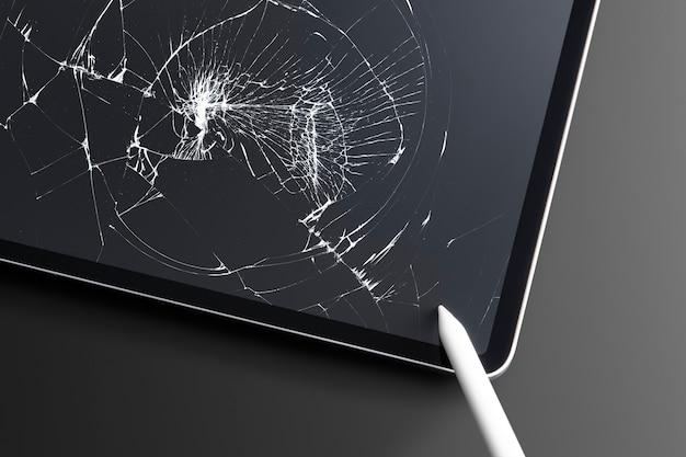 Zepsuty tablet z pękniętym ekranem potłuczonego szkła