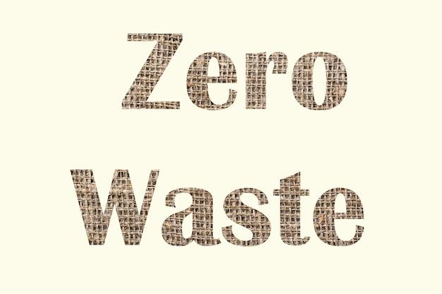 Zero marnowania. tekst wycięty ze starego tekstylnego zdjęcia w tle, napis na białym tle