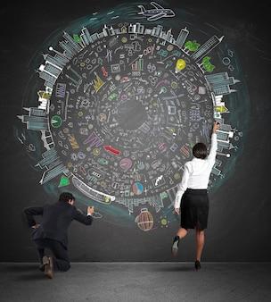 Zespół biznesowy rysuje nowy złożony projekt na ścianie