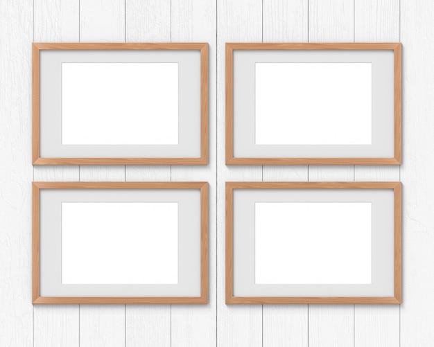 Zestaw 4 poziomych drewnianych ram z wiszącą na ścianie ramką. renderowanie 3d.
