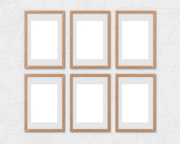 Zestaw 6 pionowych makiet drewnianych ram z ramką zawieszoną na ścianie. pusta podstawa na zdjęcie lub tekst. renderowanie 3d.