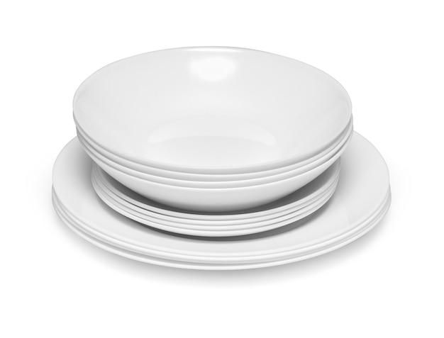 Zestaw białych naczyń na stole na jasnym tle ze ścieżką przycinającą