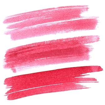 Zestaw czerwonych pociągnięć pędzlem na białym tle. żywe elementy do swojego projektu