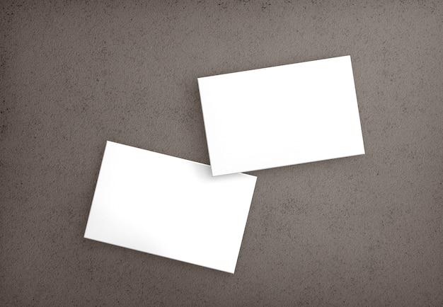 Zestaw na białym tle wizytówki na powierzchni betonu