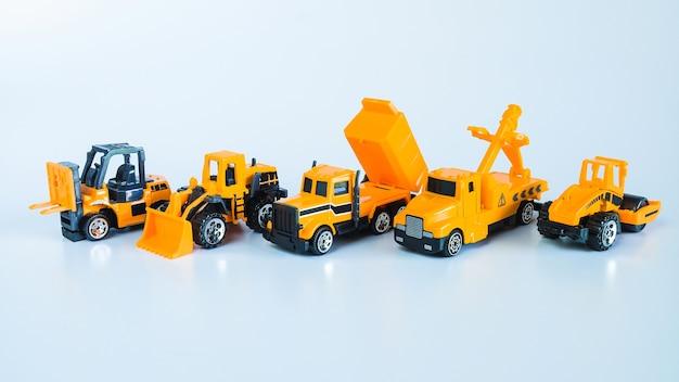 Zestaw pojazdów budowlanych i ciężkich maszynpojazdy przemysłowe żółta ciężarówka