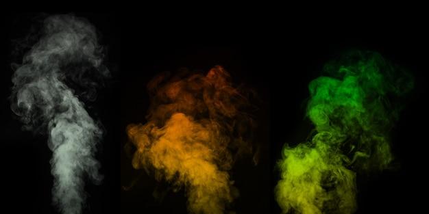 Zestaw różnokolorowych oparów, dym na czarnym tle do nakładania na swoje zdjęcia. idealny dym, para, zapach, kadzidło do twoich zdjęć. twórz mistyczne zdjęcia halloween
