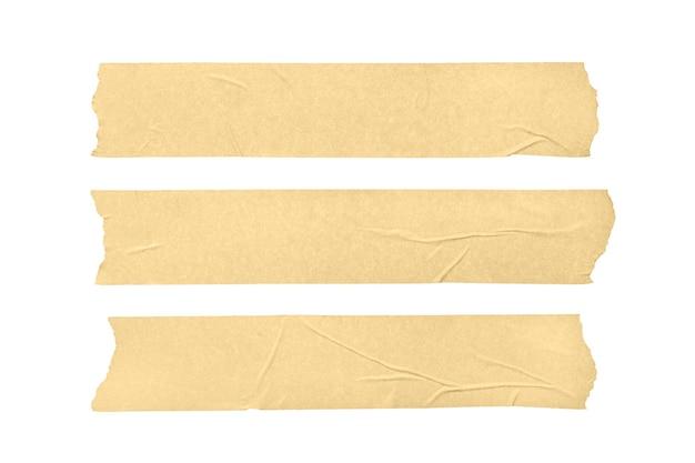 Zestaw trzech pustych taśm maskujących na białym tle.