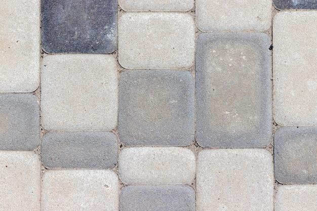 Zewnętrzne betonowe płytki podłogowe w różnych odcieniach szarości