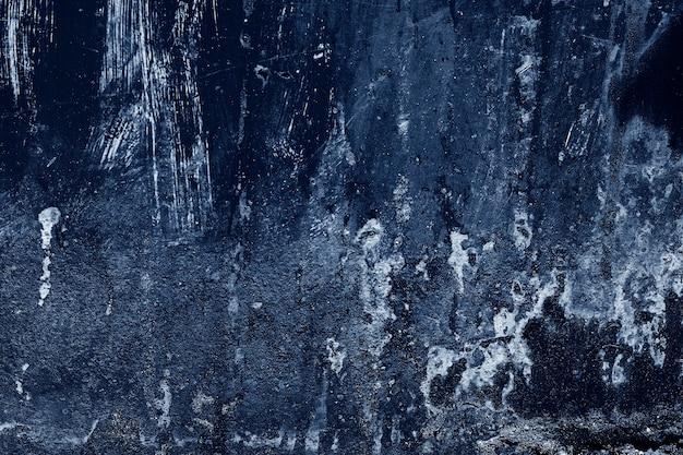 Ziarno niebieskiej farby ściany tła lub tekstury