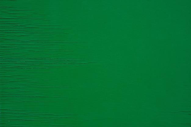 Zielona drewniana deska ze starą zieloną przestrzenią do kopiowania z bliska