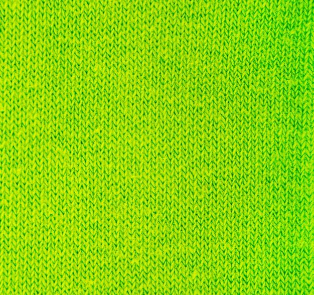 Zielona dzianina tekstura streszczenie tło.