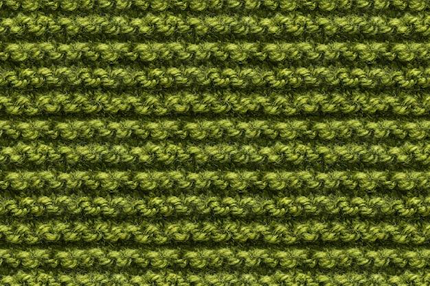 Zielona dzianina tkaniny tekstury. dziewiarska migawka makro tekstury. trykotowy