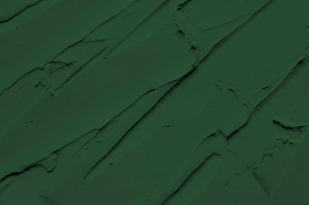 Zielona farba ścienna teksturowana w tle