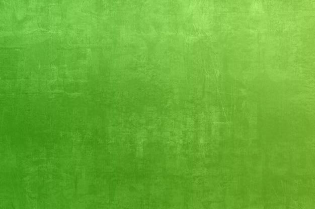 Zielona grunge plamy tekstura z gradientowym koloru rocznika filtrem retro dla tła
