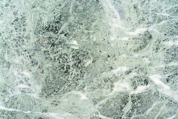 Zielona marmurowa tekstura. streszczenie powierzchni kamienia. w obliczu wzorców materiałowych.