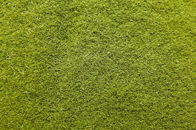 Zielona młoda trawa pszeniczna w proszku tekstury. tło żywności.