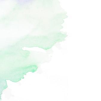 Zielona plama akwarela na białym tle