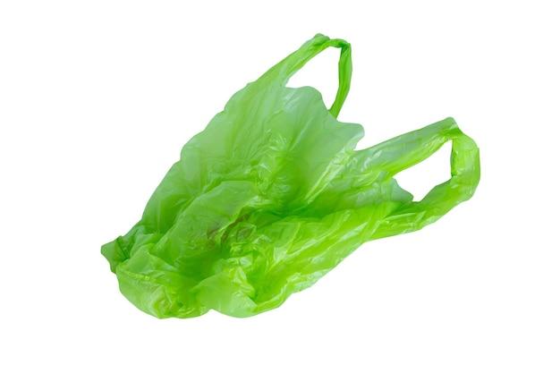 Zielona plastikowa torba na białym tle na białym tle ze ścieżką przycinającą