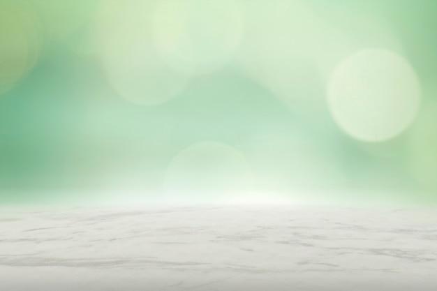 Zielona ściana bokeh z beżowym marmurowym tłem produktu podłogowego