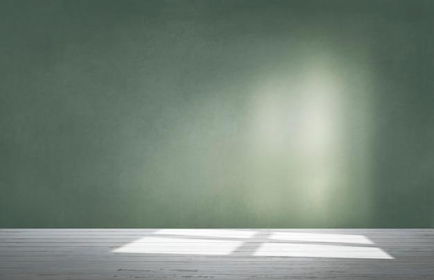 Zielona ściana w pustym pokoju z betonową podłogą