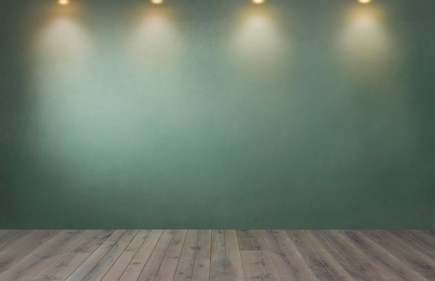Zielona ściana z rzędem światła reflektorów w pustym pokoju