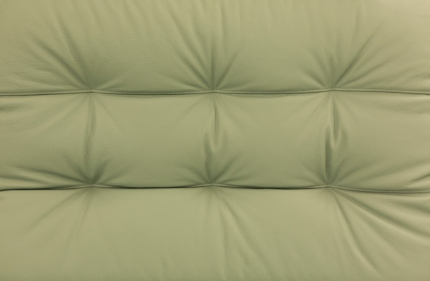 Zielona skóra tekstura tło. projekt tło wzór skóry krowy.