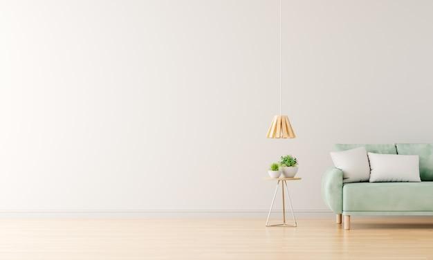 Zielona sofa w białym salonie z wolną przestrzenią na makiety