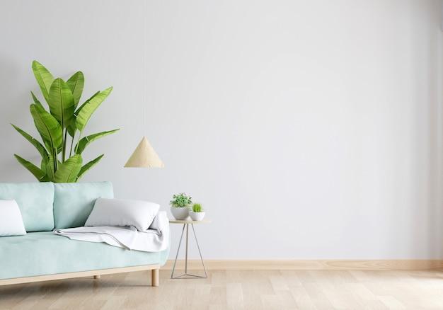 Zielona sofa w białym salonie z wolną przestrzenią