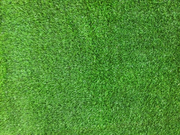 Zielona sztuczna trawa tekstura tło. obraz pulpitu zielonego trawnika.