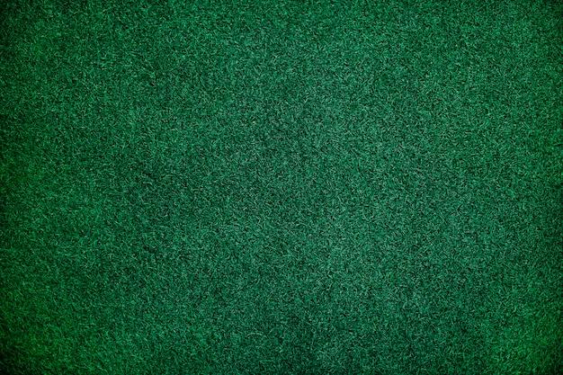 Zielona sztuczna trawa teksturowana w tle