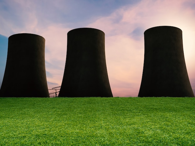 Zielona trawa z sylwetką elektrowni jądrowej