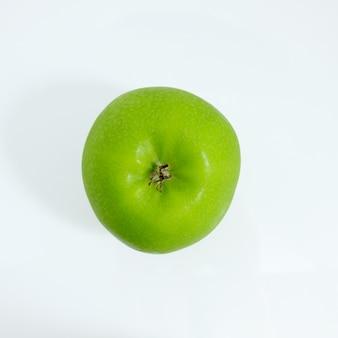 Zielone jabłko na białym tle, zielone jabłko na białym tle, owoce na białym tle
