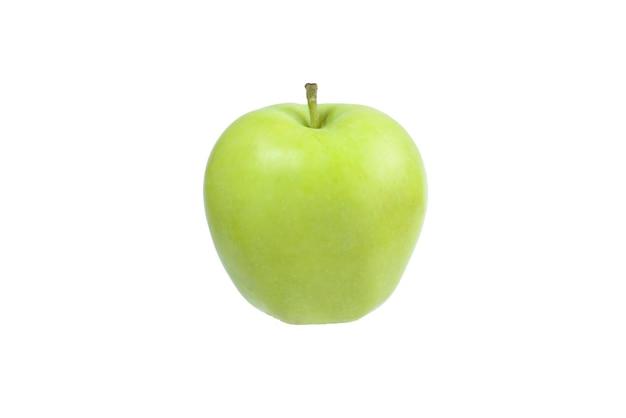 Zielone jabłko w ręce kobiety na białym tle.