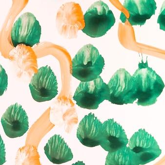 Zielone kropki i pomarańczowe linie malujące
