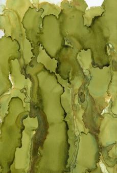 Zielone malarstwo abstrakcyjne tło. malowane tuszem tekstury.