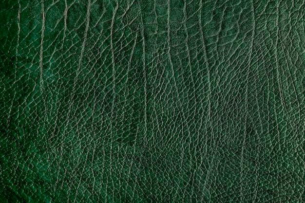 Zielone pogniecione skórzane teksturowane tło