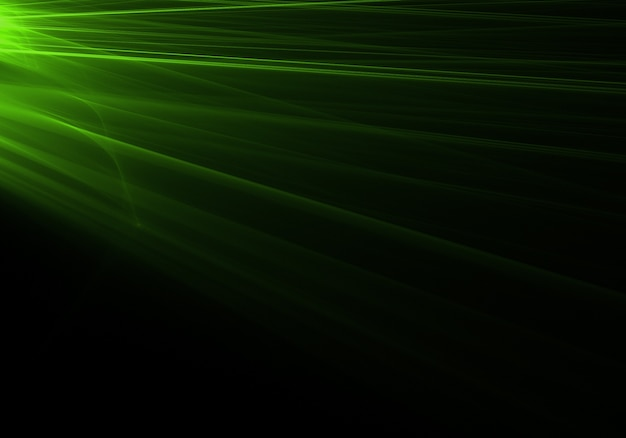 Zielone promienie świetlne pochodzące od lewej