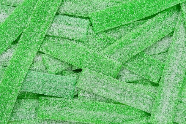 Zielone soczyste gumowate cukierki powierzchnia